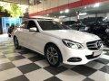 Cần bán lại xe Mercedes E250 sản xuất 2014, màu trắng giá 1 tỷ 80 tr tại Hà Nội