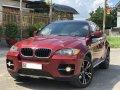 Bán xe BMW X6 model 2009, màu đỏ, nhập khẩu nguyên chiếc giá 686 triệu tại Tp.HCM