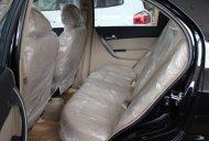 Cần bán xe Chevrolet Aveo 1.5 đời 2016, màu đen, giá tốt giá 452 triệu tại Quảng Trị