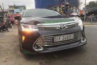 Bán Toyota Camry sản xuất 2015, màu đen giá 1 tỷ 70 tr tại Tp.HCM