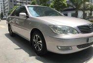Cần bán Toyota Camry 2.4 G đời 2004, màu bạc xe gia đình, giá 318tr giá 318 triệu tại Hà Nội