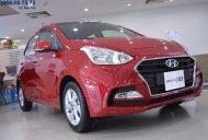 Bán xe I10 sedan 1.2 AT màu đỏ, xe giao ngay, hỗ trợ vay cao giá 415 triệu tại Tp.HCM