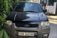 Cần bán gấp Ford Escape 3.0, đời 2004, số tự động, màu đen giá 220 triệu tại Tp.HCM