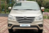 Cần bán Toyota Innova 2.0E đời 2014, màu vàng cát, biển Hà Nội giá 568 triệu tại Hà Nội