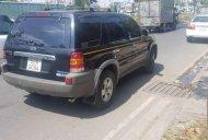 Bán ô tô Ford Escape 2.0 năm 2003, màu đen số sàn, giá chỉ 220 triệu giá 220 triệu tại Tp.HCM