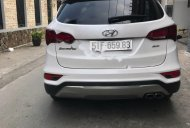 Cần bán gấp Hyundai Santa Fe 2.4L 4WD sản xuất 2016, màu trắng, xe gia đình đi kỹ giá 920 triệu tại Tp.HCM