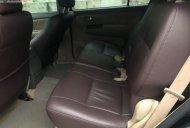 Cần bán Toyota Fortuner V đời 2013, màu đen ít sử dụng giá 690 triệu tại Hà Nội