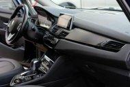 BMW 218i 2015, xanh - giảm 50% giá 840 triệu tại Tp.HCM