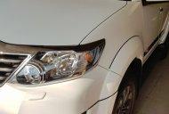 Bán Toyota Fortuner 2.7 AT sản xuất 2015, màu trắng, xe gia đình giá 835 triệu tại An Giang