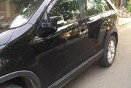 Cần bán xe Kia Sorento GMT 2.4L 2WD đời 2010, màu đen, xe đẹp, máy êm nội thất tốt giá 520 triệu tại Phú Yên