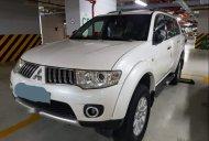Bán gấp Mitsubishi Pajero Sport sản xuất 2014, màu trắng giá 635 triệu tại Tp.HCM