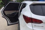 Cần bán xe Hyundai Santa Fe 2.4L 4WD đời 2017, màu trắng chính chủ giá 1 tỷ 60 tr tại Hà Nội