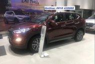 Bán Hyundai Tucson đời 2019, màu đỏ, giá tốt giá 873 triệu tại Tp.HCM