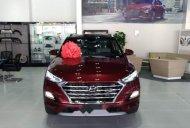Bán Hyundai Tucson năm sản xuất 2019, màu đỏ giá 878 triệu tại Tp.HCM