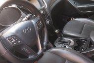 Bán xe Hyundai Santa Fe sản xuất 2015, màu đen chính chủ giá 930 triệu tại Tp.HCM