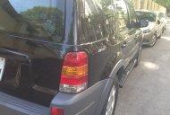 Bán xe Ford Escape 3.0 V6 2004, màu đen, còn mới giá 160 triệu tại Thanh Hóa