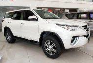 Bán Toyota Fortuner 2.4G 4x2 AT năm 2019, màu trắng giá 1 tỷ 56 tr tại Hà Nội