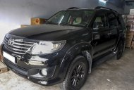 Cần bán Toyota Fortuner V 2.7AT 2012, màu đen giá 596 triệu tại Tp.HCM