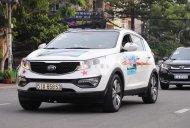 Cần bán gấp Kia Sportage 2.0AT năm sản xuất 2014, màu trắng giá cạnh tranh giá 650 triệu tại Tp.HCM