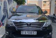 Cần bán lại xe Toyota Fortuner năm 2013, màu đen ít sử dụng giá 599 triệu tại Tp.HCM