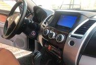 Cần bán Mitsubishi Pajero Sport 4x2AT đời 2014, màu đen chính chủ giá 710 triệu tại Hà Nội