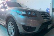 Bán Hyundai Santa Fe sản xuất 2010, màu bạc, giá tốt giá 668 triệu tại Tp.HCM