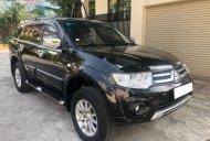 Cần bán xe cũ Mitsubishi Pajero Sport D 4x2 AT đời 2014, màu đen giá 715 triệu tại Hà Nội
