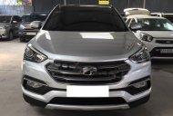 Cần bán gấp Hyundai Santa Fe năm 2017, màu bạc xe còn mới giá 1 tỷ 6 tr tại Tp.HCM