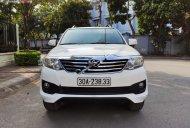 Bán Toyota Fortuner 2.7V 4x2 AT 2014, màu trắng, giá 695tr giá 695 triệu tại Hà Nội