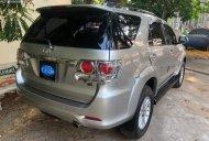 Cần bán Toyota Fortuner 2.5G sản xuất 2014, màu bạc, số sàn giá 680 triệu tại Tp.HCM