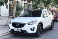 Bán Mazda CX 5 sản xuất 2014, màu trắng, xe gia đình giá 630 triệu tại Tp.HCM