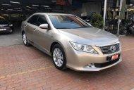 Bán Toyota Camry đời 2014, màu vàng cát, giá rẻ giá 670 triệu tại Tp.HCM