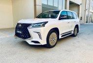 Bán Lexus LX 570 MBS 4 ghế vip màu trắng nội thất da bò sản xuất 2020 nhập mới 100% giá 10 tỷ 300 tr tại Hà Nội