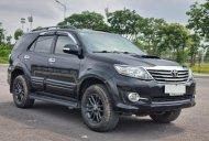 Cần bán gấp Toyota Fortuner 2016, màu đen, số sàn, giá 715tr giá 715 triệu tại Hà Nội